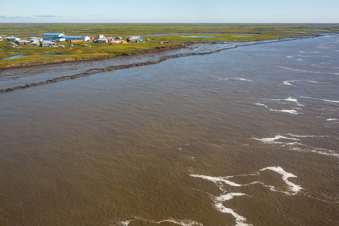 The village of Newtok, in southwest Alaska, on Tuesday, August 4, 2015. The community has lost three miles of shoreline to the Ninglick River over the past 60 years, and is in the process of moving to a new site on higher ground 9 miles away.