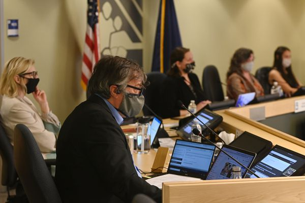 Anchorage School Board member Andy Holleman listens to in-person public testimony on an ASD Anti-Racism policy being discussed during the school board meeting on Tuesday, April 20, 2021. (Bill Roth / ADN)