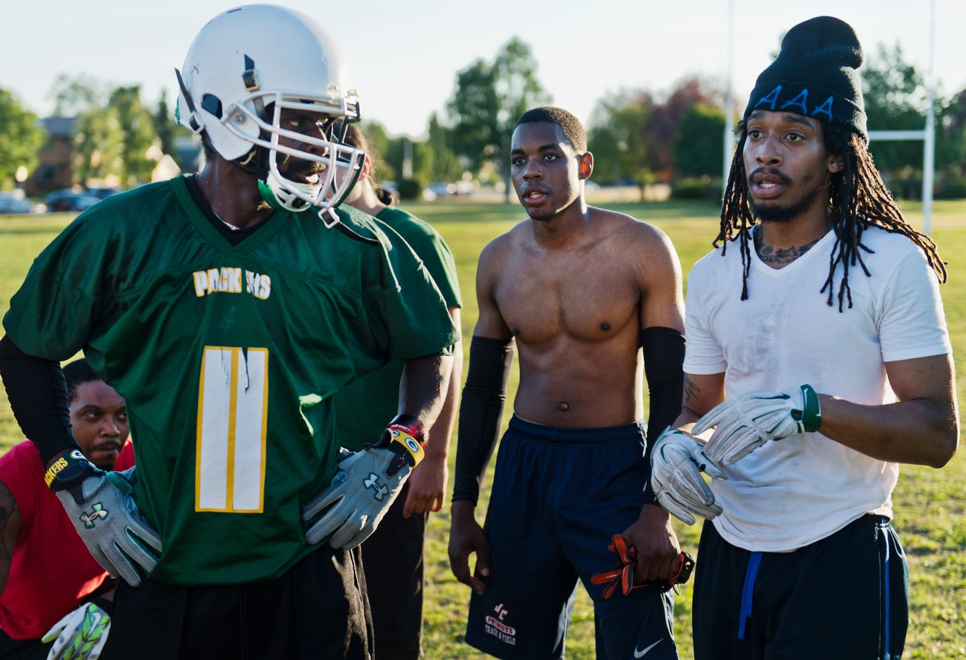Kendall McVay, Dalontia Wilson and Mitchell Joseph talk with their coach during an evening practice before the season began on July 18, 2018. (Marc Lester / ADN)