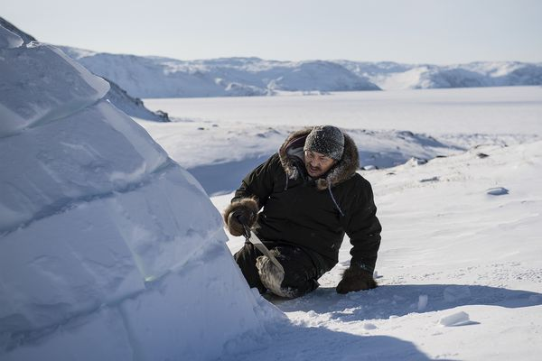Adami Sakiagak demonstrates how to build an igloo near Kangiqsujuaq, Nunavik, Quebec, Canada, March 2, 2017. Sakiagak, a 57-year-old Inuit, builds igloos to teach younger generations the disappearing craft. (Aaron Vincent Elkaim / The New York Times)