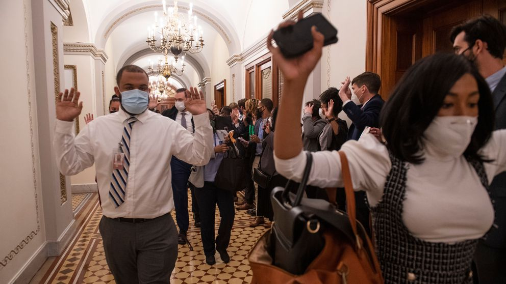 Congressional staff members are ushered out of the Capitol after a mob of rioters breached the building on Wednesday, Jan. 6, 2021. Photo for The Washington Post by Amanda Voisard