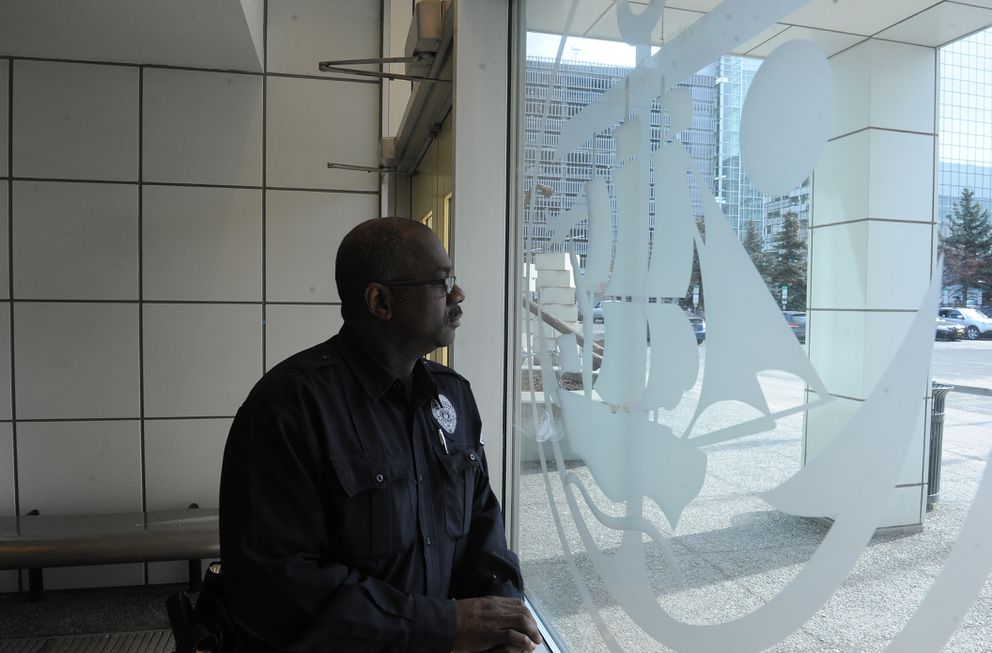 Michael Maberry, a security guard for Guardian Security, is on duty at Anchorage City Hall in downtown Anchorage, AK on Thursday April 5, 2018. (Bob Hallinen / ADN)