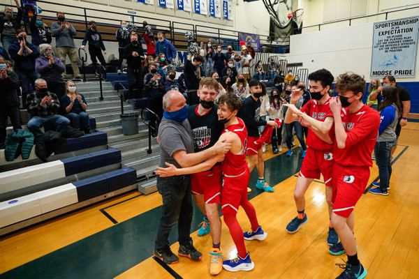Lumen Christi players celebrate after their 77-30 win in the ASAA state 1A boys basketball championship game against Tanana on Saturday, April 3, 2021 at Palmer High School. (Loren Holmes / ADN)