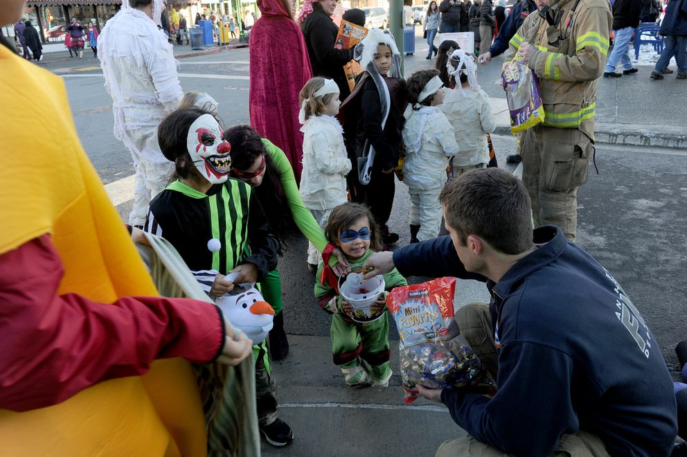 Costumed kids and adults converged on downtown Anchorage as the Anchorage Downtown Partnership, Ltd. and the downtown businesses hosted a trick or treat day on Halloween in downtown Anchorage, AK on Saturday Oct. 31, 2015. (Bob Hallinen / Alaska Dispatch News)