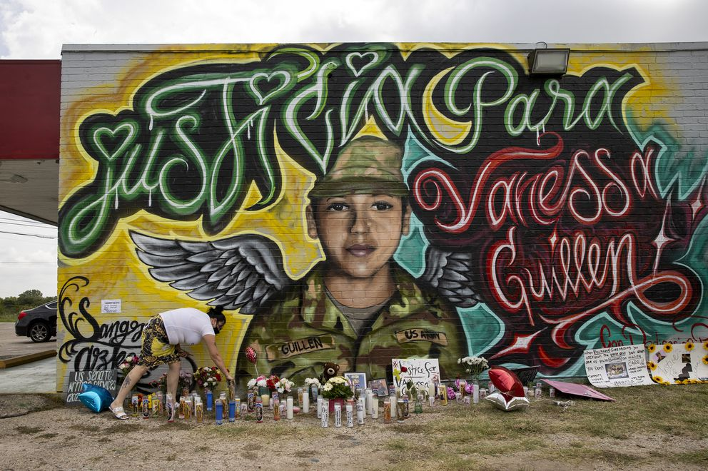 Veronica Carbajal places a candle at a mural for Army Spc. Vanessa Guillen in Austin, Texas, on Monday July 6, 2020. (Jay Janner/Austin American-Statesman via AP)