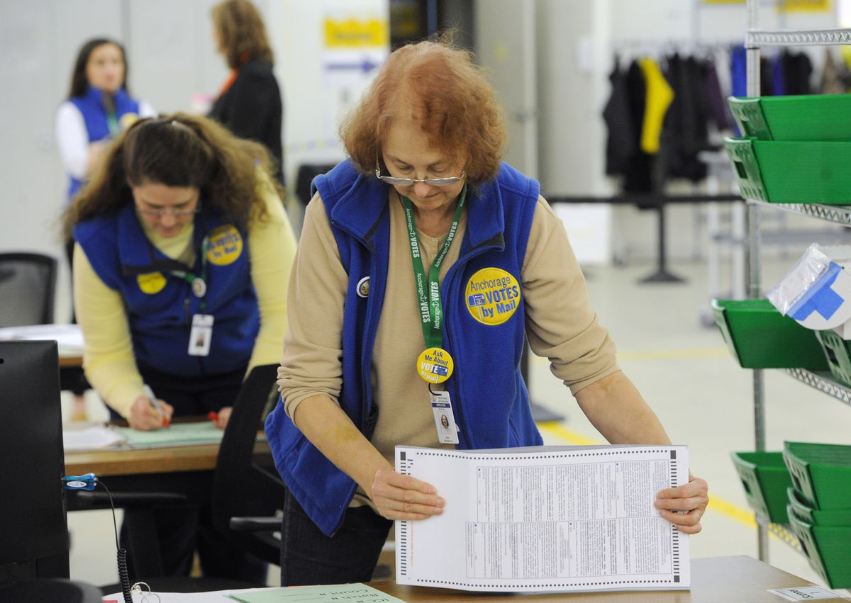 Election workers Sheri Whitethorne, right, and Karen Walker scanned ballots at the MOA Election Center on Election Day, April 2, 2019, during the regular municipal election. (Bill Roth / ADN)