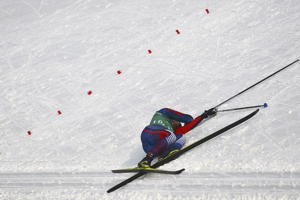 Cross-Country Skiing - Pyeongchang 2018 Winter Olympics - Men's 4x10 km Relay - Alpensia Cross-Country Skiing Centre - Pyeongchang, South Korea - February 18, 2018 - Reese Hanneman of the U.S. lies on the snow. REUTERS/Carlos Barria