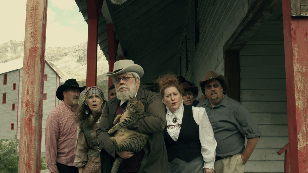 "Townfolk assemble in a scene from ""Soapy Smith Rides Again."""