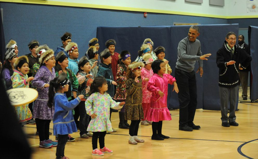 President Obama dances with the traditional Yup'ik dance group at the Dillingham middle school in Dillingham on Wednesday, Sept. 2, 2015. (Bob Hallinen / Alaska Dispatch News)