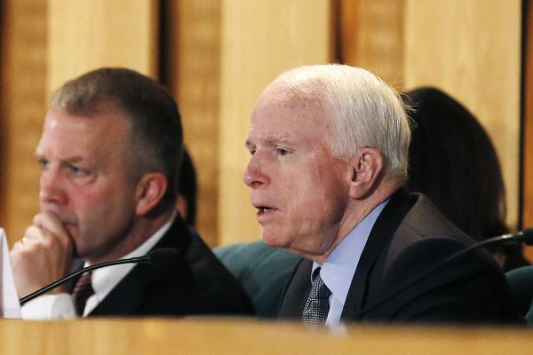 Sen. John McCain, R-Ariz., right, speaks as he is joined by Sen. Dan Sullivan, R-AK, left, as they discuss the current state of the VA Medical Center in Phoenix during a Senate Veterans' Affairs Committee field hearing Monday, Dec. 14, 2015, in Gilbert, Ariz. (AP Photo/Ross D. Franklin)