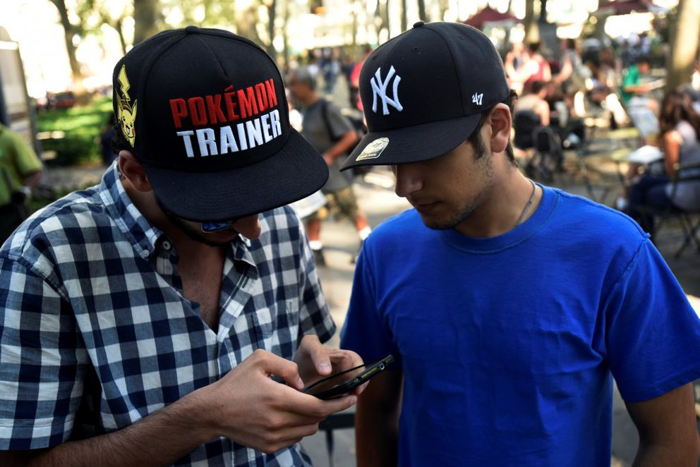 "A man wears a Pokemon-themed hat as he plays the augmented reality mobile game ""Pokemon Go"" by Nintendo in Bryant Park, New York City. (REUTERS/Mark Kauzlarich)"
