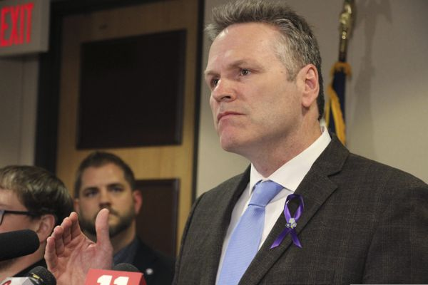 FILE - In this March 12, 2020 file photon Alaska Gov. Mike Dunleavy speaks during a news conference in Anchorage, Alaska. Alaska Senate leaders said Friday, March 20, 2020, that lawmakers are pushing to complete their most pressing work in the coming days, as concerns about the coronavirus persist. (AP Photo/Mark Thiessen,File)
