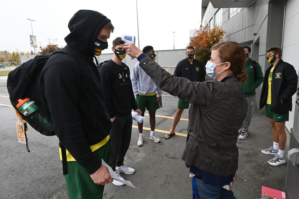 UAA athletic trainer Rachel Butler takes the temperature of Keegan Crosby prior to a workout Wednesday. (Bill Roth / ADN)