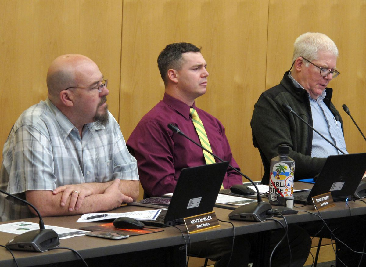 Members of Alaska's Marijuana Control Board listen to public comment during a meeting on Wednesday, Feb. 20, 2019, in Juneau, Alaska. Shown are, from left, Nicholas Miller, Brandon Emmett and Mark Springer. (AP Photo/Becky Bohrer)