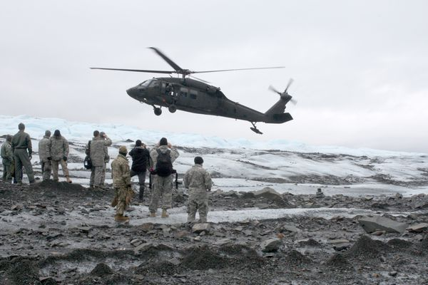 A Black Hawk helicopter lands on Colony Glacier to pick up service members. Photographed Wednesday, June 21, 2017. (Laurel Andrews / Alaska Dispatch News)