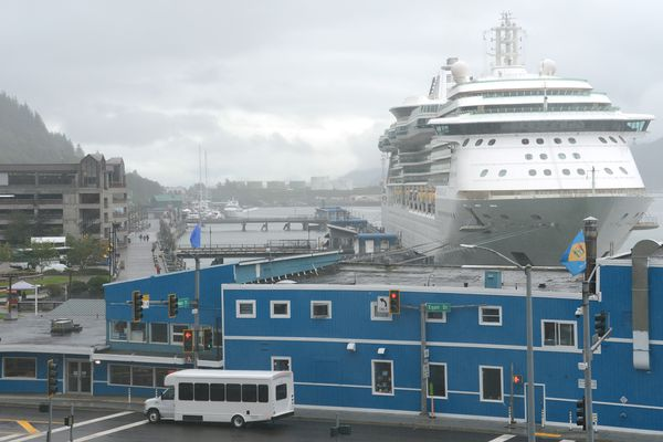The Royal Caribbean cruise ship Serenade of the Seas looms above downtown Juneau on Friday, July 23, 2021. The passenger-carrying cruise ship arrived in Alaska's largest cruise ship port, ending a 21-month absence caused by the COVID-19 pandemic. (James Brooks / ADN)