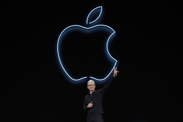 FILE - In this June 3, 2019, file photo, Apple CEO Tim Cook waves after speaking at the Apple Worldwide Developers Conference in San Jose, Calif. Cook has forged his own distinctive legacy. He will mark his ninth anniversary as Apple's CEO Monday, Aug. 24, 2020 -- the same day the company will split its stock for the second time during his reign. (AP Photo/Jeff Chiu, File)