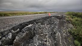 As Alaska permafrost melts, roads sink, bridges tilt and greenhouse gases escape