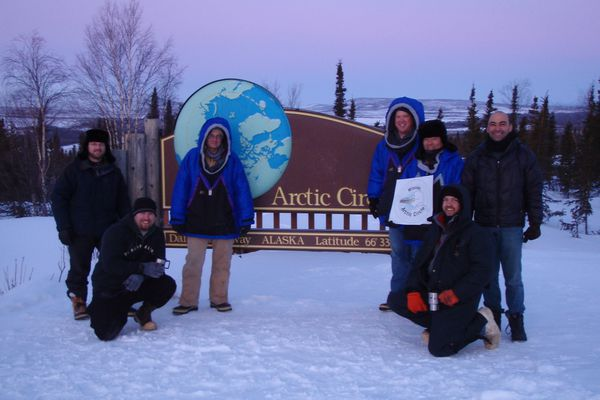 "From left, Ryan West, Shawn Freitas, John Whittington, Doug Morrow, Bernie Tao, Darrin Marshall and Andy Soria at the Arctic Circle pullout on the Dalton Highway, where they camped in March 2009 to test the cold-weather performance of ""Permaflo Biodiesel."" (Photo courtesy Darrin Marshall)"