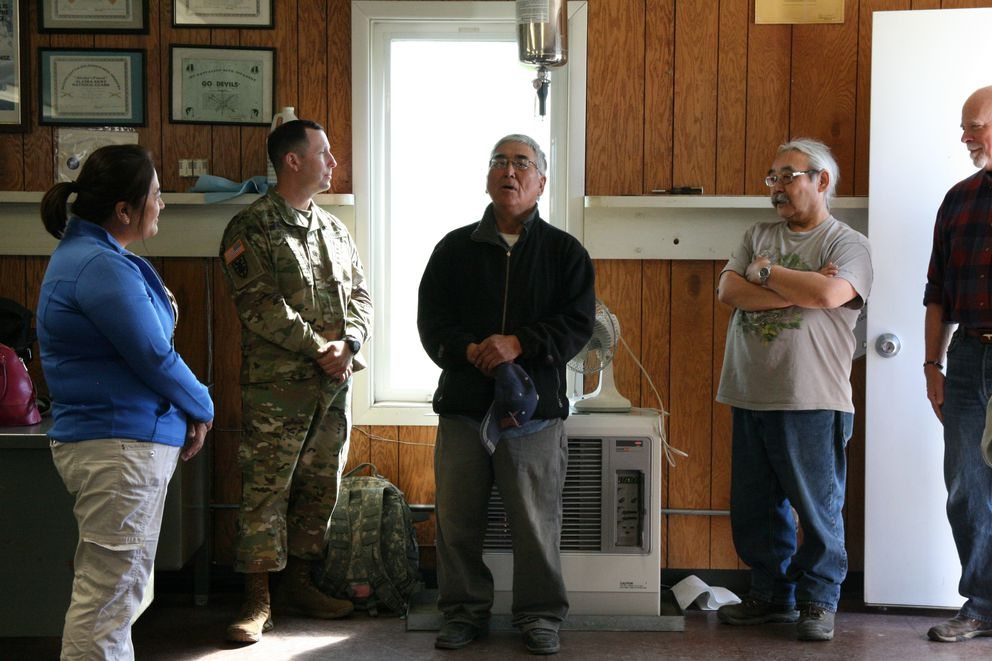 Asst. Army Sec. Debra Wada, in blue, listens to Kwethluk Mayor Max Angellan, center, on Tuesday, June 7, during a meeting in the village of Kwethluk with Alaska National Guard leaders, military members from the village and tribal leaders. (Lisa Demer / Alaska Dispatch News)
