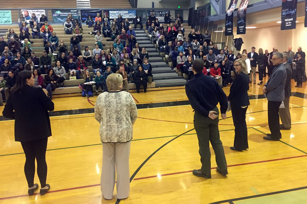 Members of the Anchorage School Board and Anchorage School District officials speak to the crowd in the Chugiak High gym during a public meeting on the future of secondary education in Eagle River on Tuesday at Chugiak High School. (Matt Tunseth / Chugiak-Eagle River Star)