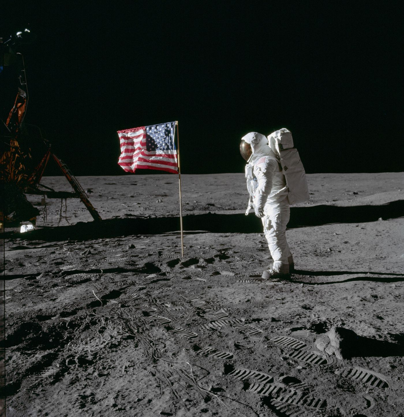 Buzz Aldrin poses for a photo next to the U.S. flag. MUST CREDIT: NASA