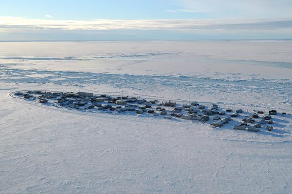 Aerial view of the village of Kivalina, which is threatened by coastal erosion of the long barrier island between the Chukchi Sea in the distance and a lagoon at the mouth of the Kivalina River in the foreground on Monday, Feb. 16, 2015. (Bill Roth / ADN)