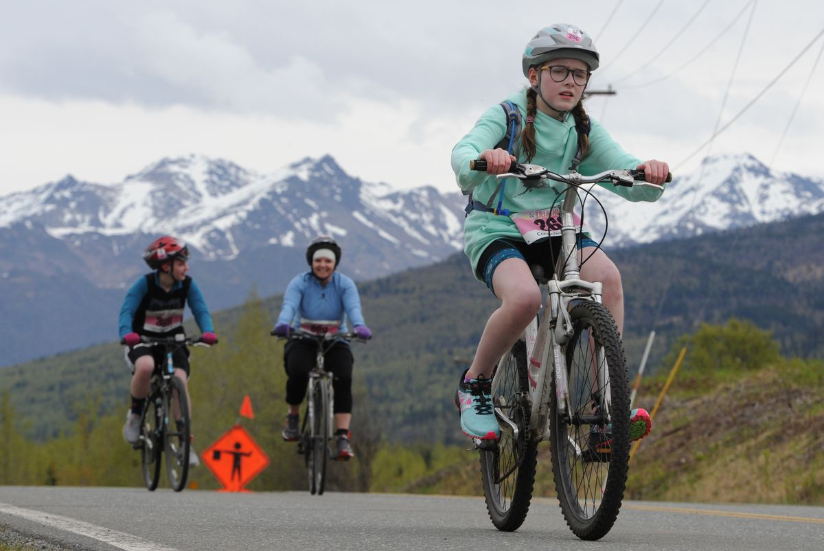Ava Beecroft competes in the 12-mile bike portion of the 35th annual Gold Nugget Triathlon on Sunday. (Bill Roth / ADN)