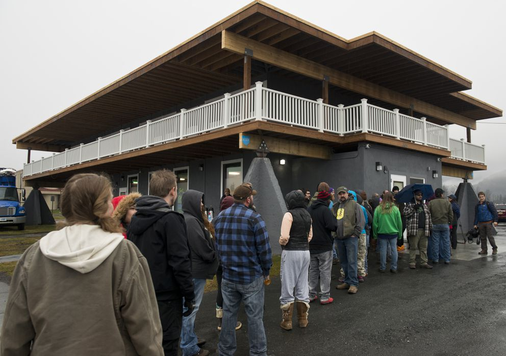 A line forms outside Herbal Outfitters. The marijuana retailer opened its doors to customers for the first time in Valdez on Saturday. (Marc Lester / Alaska Dispatch News)