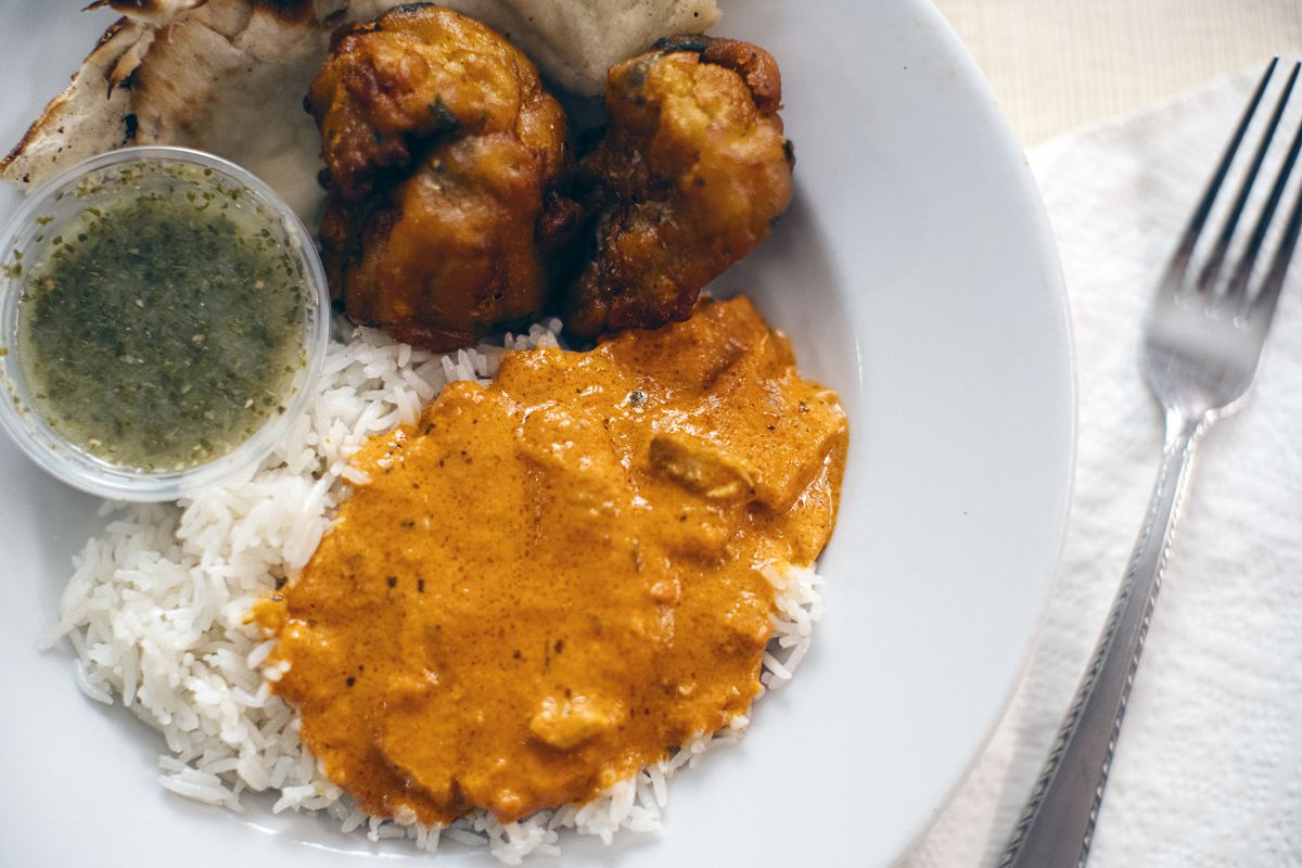 Chicken mahkni with vegetable pakoras and naan, from Bombay South in Anchorage. (Photo by Kerry Tasker)