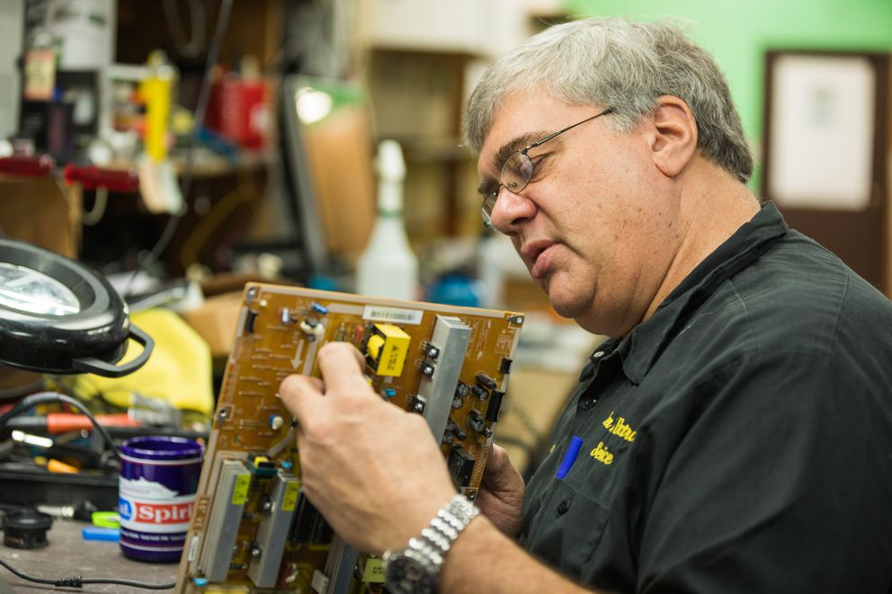 Ken Bartz of Ken's Electronic Repair works on fixing a television at his repair shop in Anchorage on Wednesday, Oct. 5, 2016. (Loren Holmes / Alaska Dispatch News)