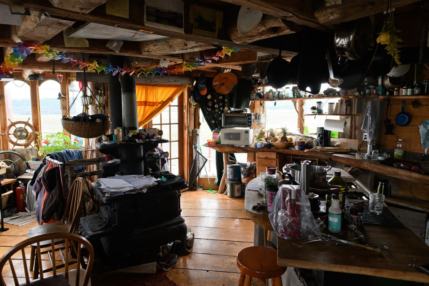 Drew O'Neill's father-in-law, Bob Cousins, built a home on an old boat on the Homer Spit. (Marc Lester / ADN)
