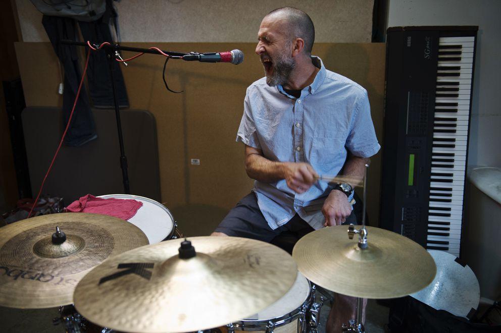 Drummer Jason Lessard plays during rehearsal. (Marc Lester / ADN)