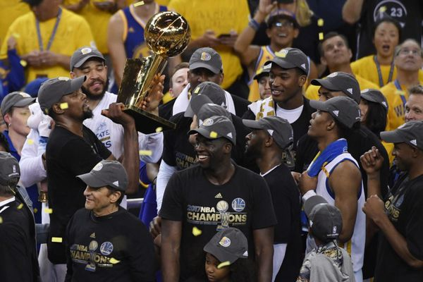 Jun 12, 2017; Oakland, CA, USA; Golden State Warriors forward Kevin Durant hoists the Larry O'Brien Trophy after defeating the Cleveland Cavaliers in game five of the 2017 NBA Finals at Oracle Arena. Mandatory Credit: Kyle Terada-USA TODAY Sports