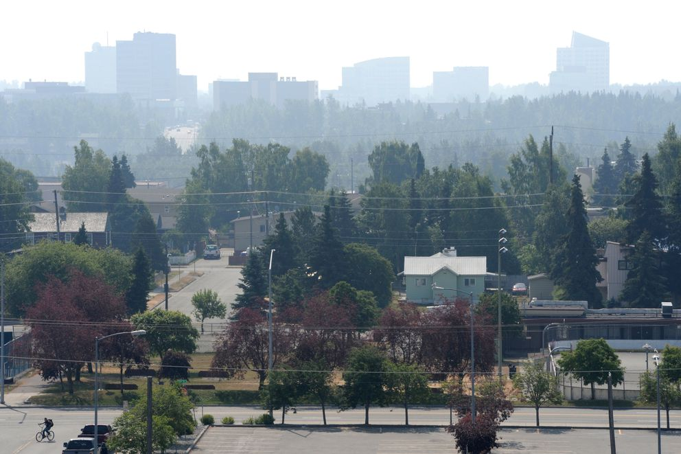 Midtown is obscured by smoke from the 92,657 acres, or about 144 square mile Swan Lake wildfire on the Kenai Peninsula has settled in Anchorage reducing the visibly and lowering the air quality to an