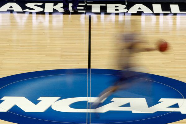 FILE - In this March 14, 2012, file photo, a player runs across the NCAA logo during practice at the NCAA tournament college basketball in Pittsburgh. The NCAA Board of Governors took the first step Tuesday, Oct. 29, 2019, toward allowing athletes to cash in on their fame, voting unanimously to clear the way for the amateur athletes to