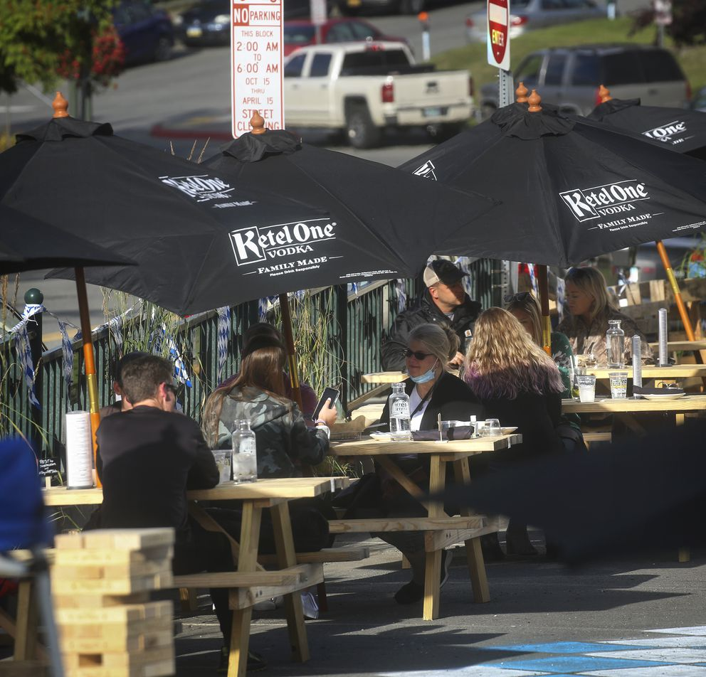People dine in the outdoor seating area at 49th State Brewing Co. in Anchorage on Aug. 7, 2020. (Emily Mesner / ADN)