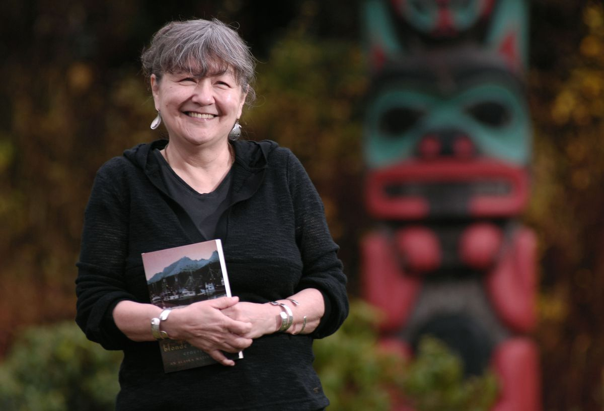 "Ernestine Hayes was photographed in 2006 at the University of Alaska Southeast with her book ""Blonde Indian, an Alaska Native Memoir,"" about growing up in Southeast Alaska. (Photo by Michael Penn)"