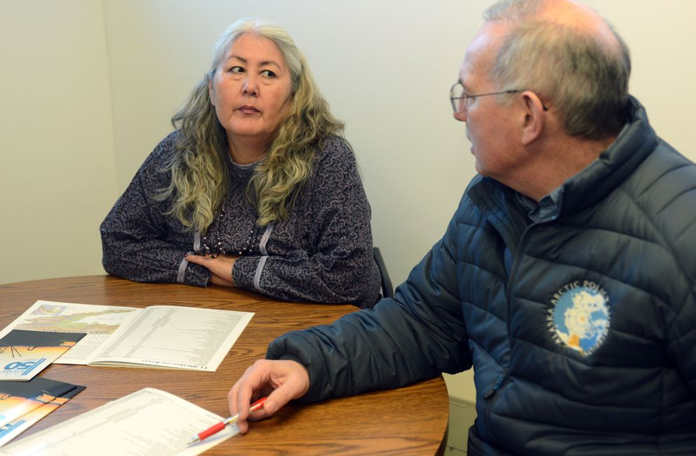 """Bristol Bay Native Association Chief Administrative Officer Wassiliisia """"Dee Dee"""" Bennis, left, confers with Rep. Bryce Edgmon on state budget cuts and their effects on local services on Tuesday in Dillingham. (Erik Hill / Alaska Dispatch News)"""
