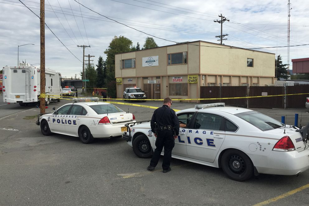 Anchorage Police Department officers respond to the scene of the triple shooting. (Erik Hill / Alaska Dispatch News)