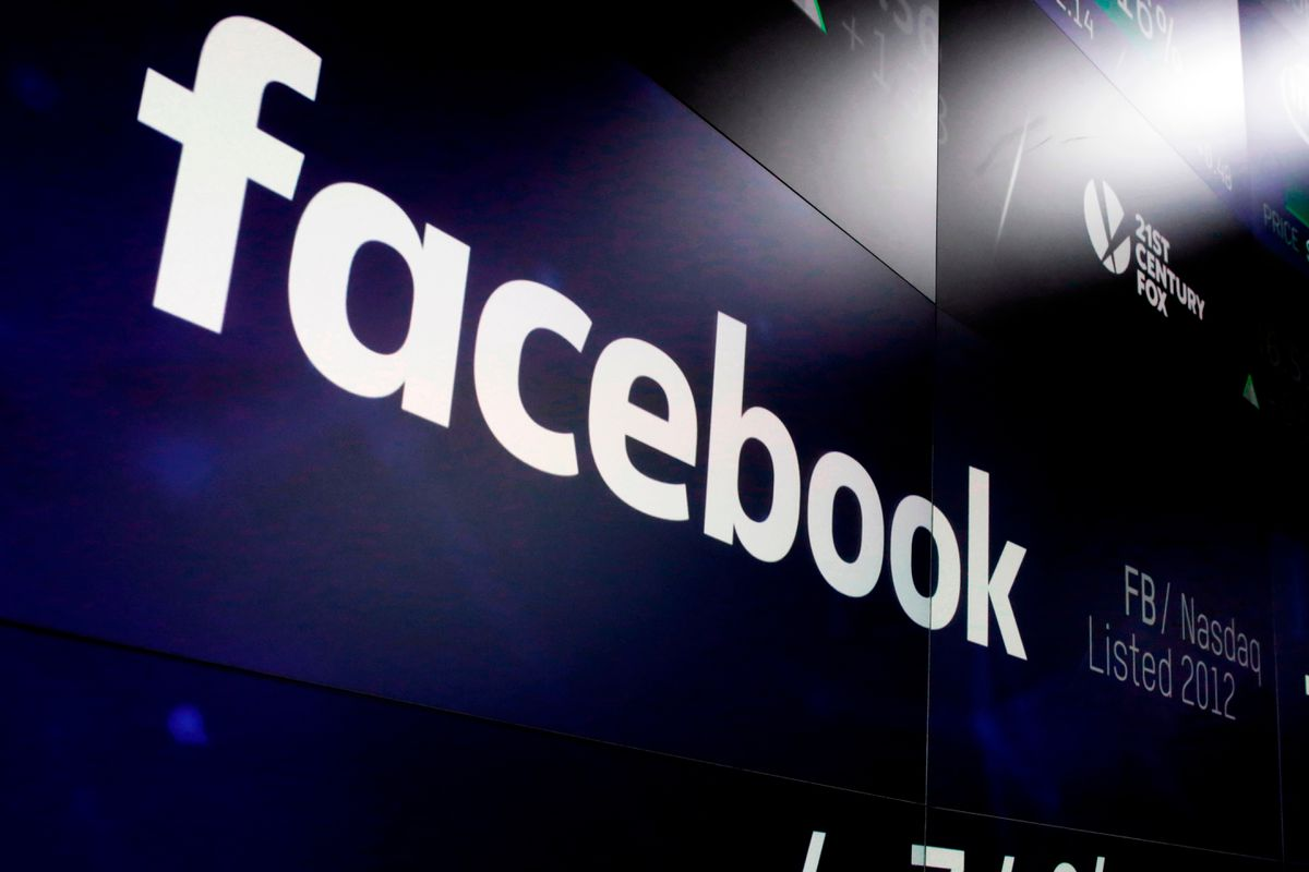 FILE – This March 29, 2018 file photo shows the Facebook logo on screens at the Nasdaq MarketSite in New York's Times Square. (AP Photo/Richard Drew, File)