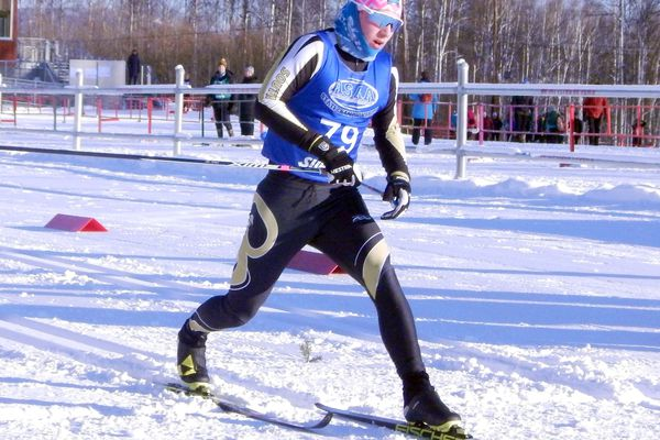 South Anchorage's Zanden McMullen crosses the finish line for the boys 7.5-kilometer classic technique race of the state high school Nordic ski championships on Thursday at the Birch Hill Recreation Area in Fairbanks. McMullen won the race in 22 minutes, 14 seconds. DANNY MARTIN / NEWS-MINER