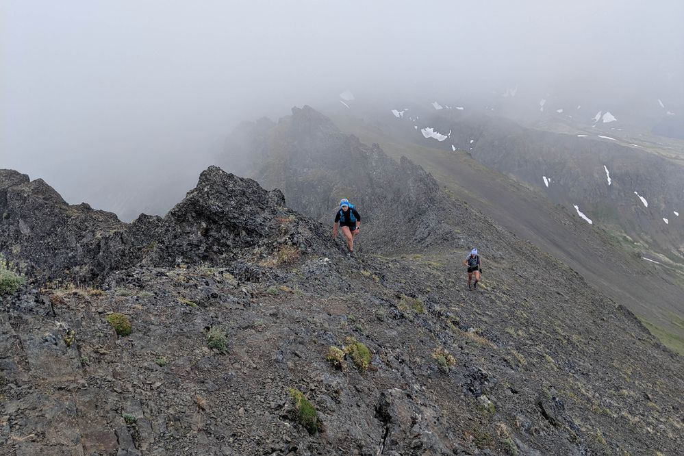 April McAnly, left, and Abby Jahn negotiate rocky terrain at 5,383-foot Temptation Peak, part of the 12-peak Chugach linkup the climbers completed in less than 24 hours on Saturday, July 20, 2019. (Photo by Julianne Dickerson)