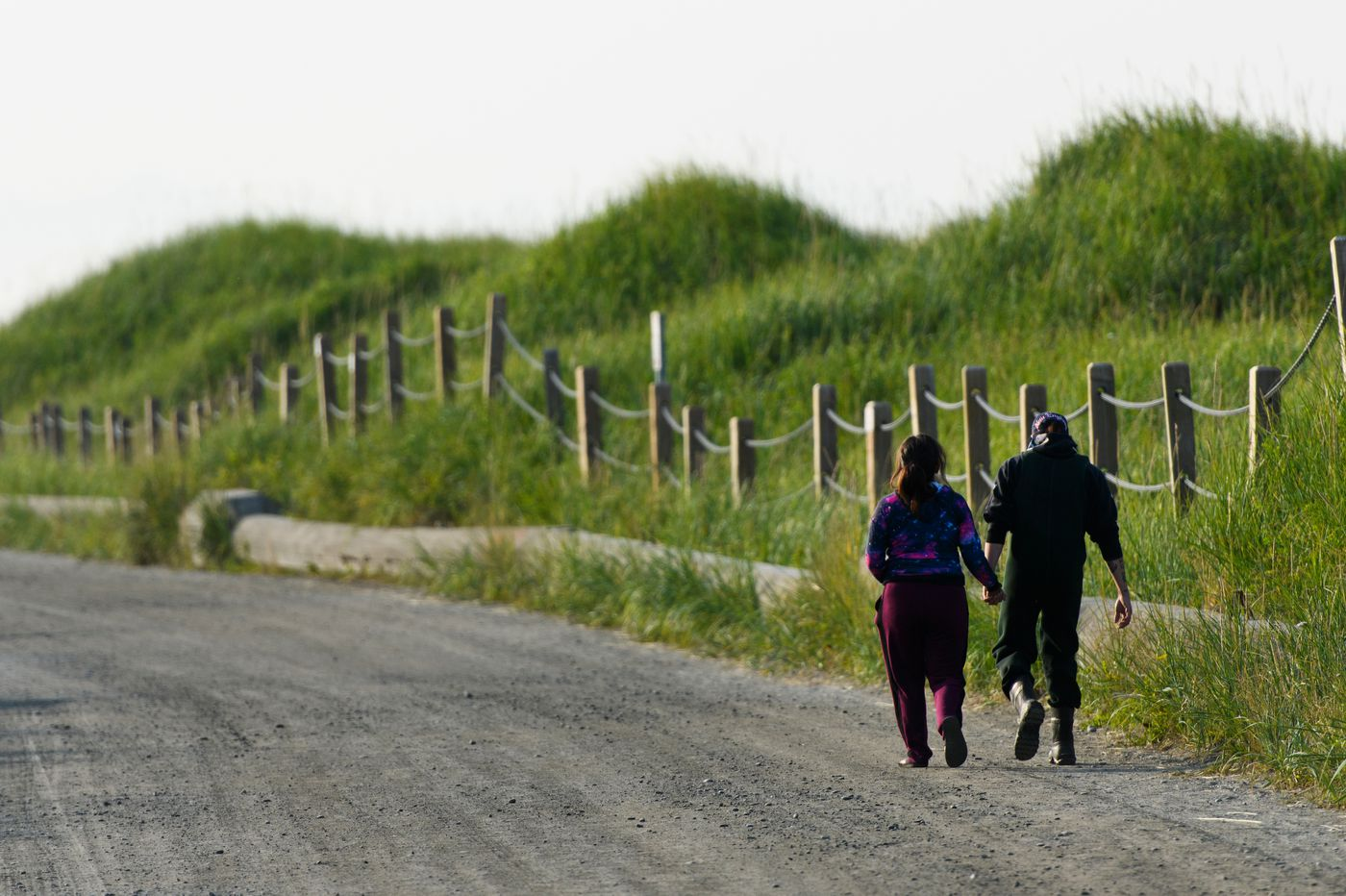 A couple walks from the parking area to the shore of the Kenai River early Thursday. (Marc Lester / ADN)