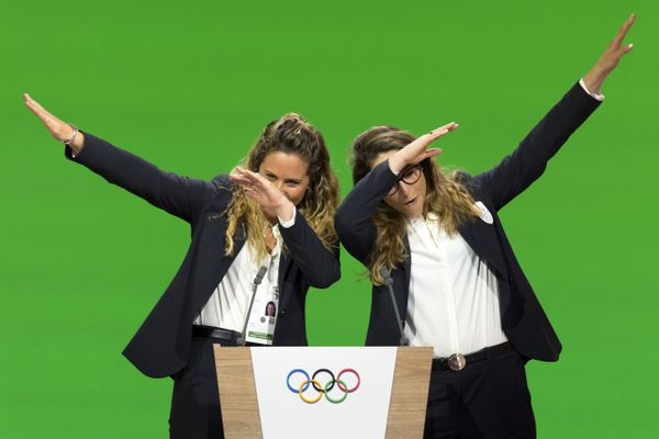 Italian snowboarder Michela Moioli, left, and Italian skier Sofia Goggia, right, dab after speaking during the presentation final presentation of the Milan-Cortina candidate cities the first day of the 134th Session of the International Olympic Committee (IOC), at the SwissTech Convention Centre, in Lausanne, Switzerland, Monday, June 24, 2019. The host city of the 2026 Olympic Winter Games will be decided during the134th IOC Session. Stockholm-Are in Sweden and Milan-Cortina in Italy are the two candidate cities for the Olympic Winter Games 2026. (Laurent Gillieron/Keystone via AP)