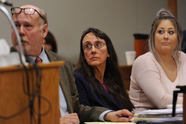 Adoptive mother Anya James, center, listens to testimony during her sentencing at the Nesbett Courthouse on Tuesday, Oct. 24, 2017. (Bill Roth / Alaska Dispatch News)