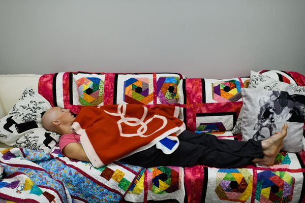 Exhausted from traveling and ill from the side effects of chemotherapy, Kikkan Randall sleeps on her sofa in Penticton, B.C., on October 6, 2018. (Marc Lester / ADN)