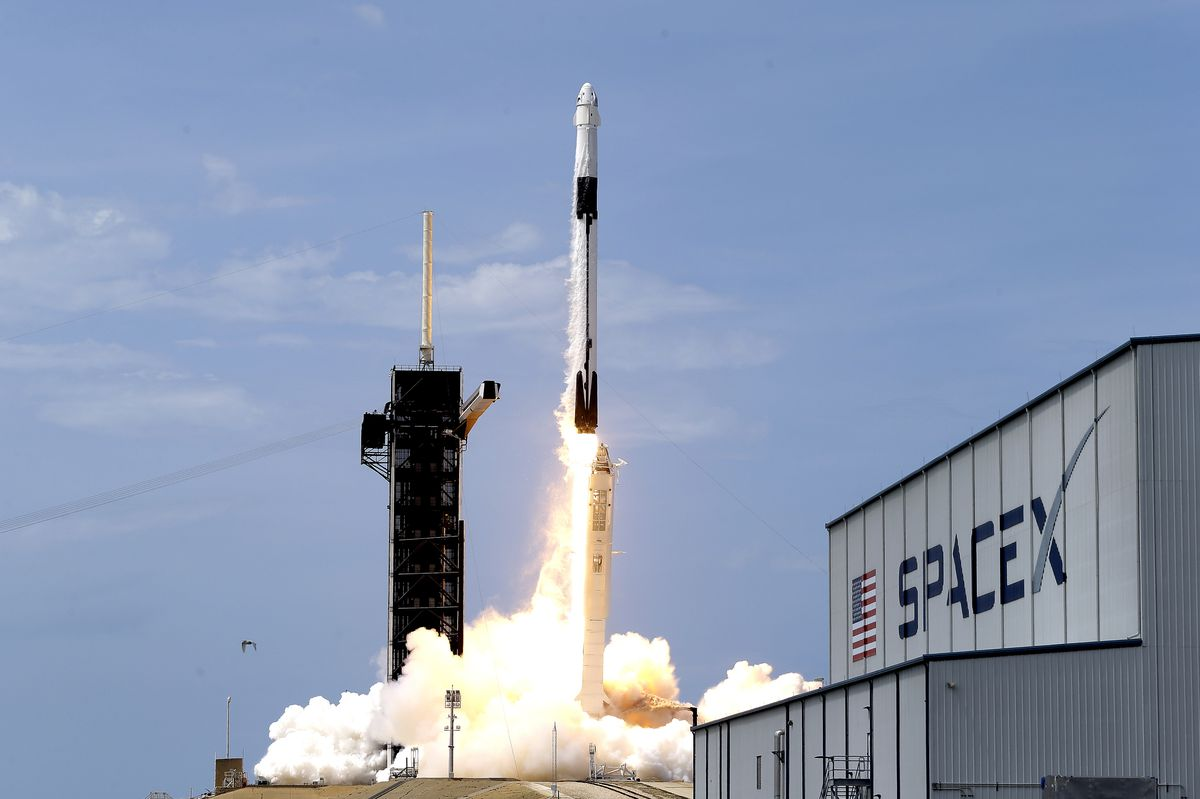 FILE - In this May 30, 2020, file photo, a SpaceX Falcon 9, with NASA astronauts Doug Hurley and Bob Behnken in the Dragon crew capsule, lifts off from Pad 39-A at the Kennedy Space Center in Cape Canaveral, Fla. (AP Photo/John Raoux, File)