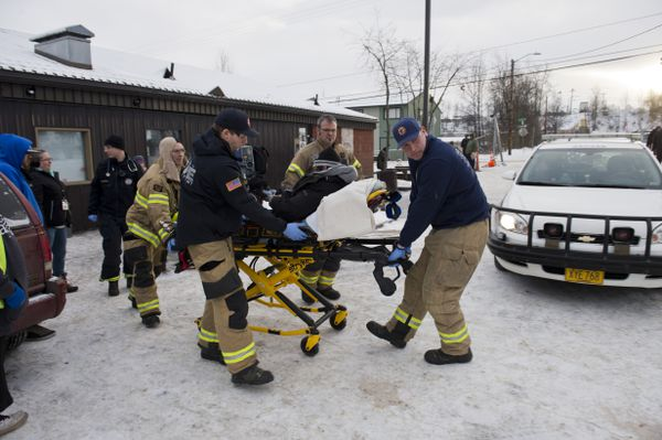 Anchorage paramedics transport a man from outside Bean's Cafe on Jan. 10. (Marc Lester / ADN)