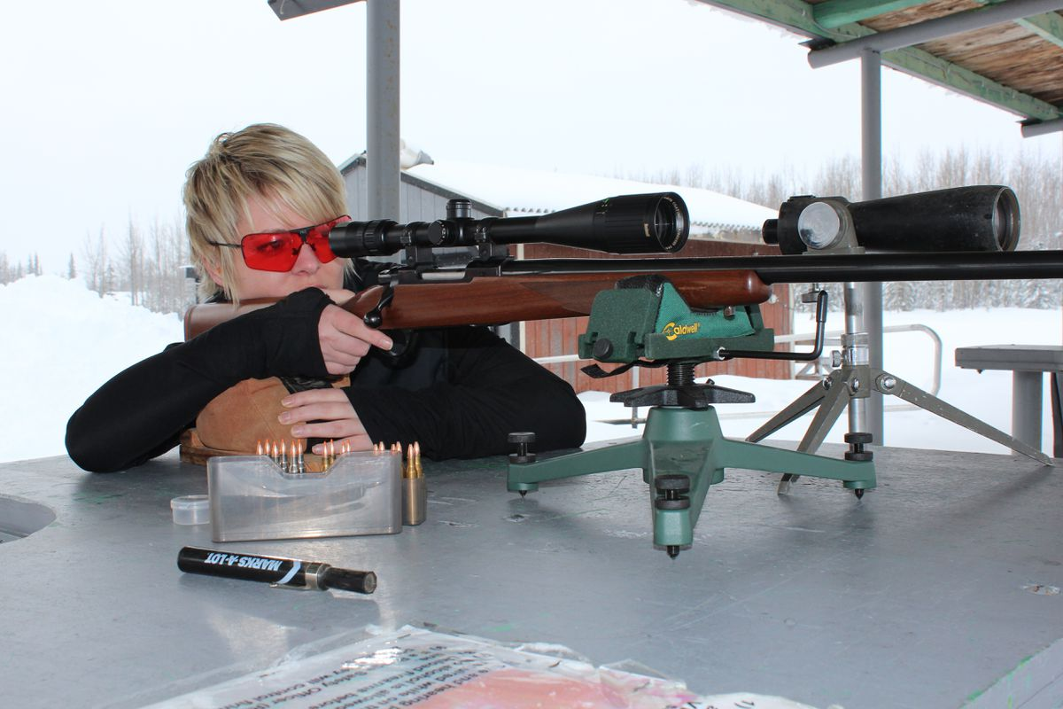 A solid rest is a must for sighting in, as Christine Cunningham demonstrates at the Snow Shoe Gun Club in Kenai. (Photo by Steve Meyer)